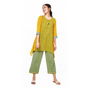 Global Desi Printed Tunic Styled with Butter Fly Cut hem line - Mustard