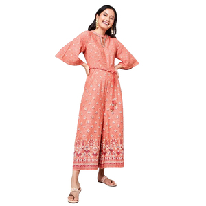 Global Desi Flared Printed Bell Sleeve Jumpsuit Styled With Waist Tie-Up & Chocker Neck  - Pink